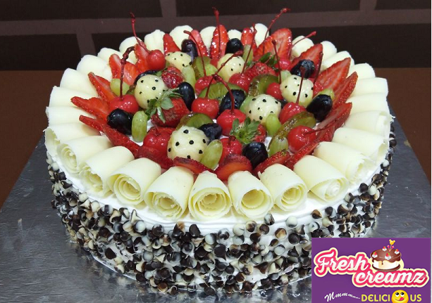 an awesome berries and chocolate freshcreamz cake